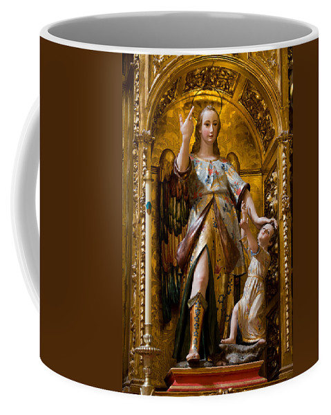 Saint Coffee Mug featuring the photograph Jesus And Angel Sculptures In Mezquita by Artur Bogacki