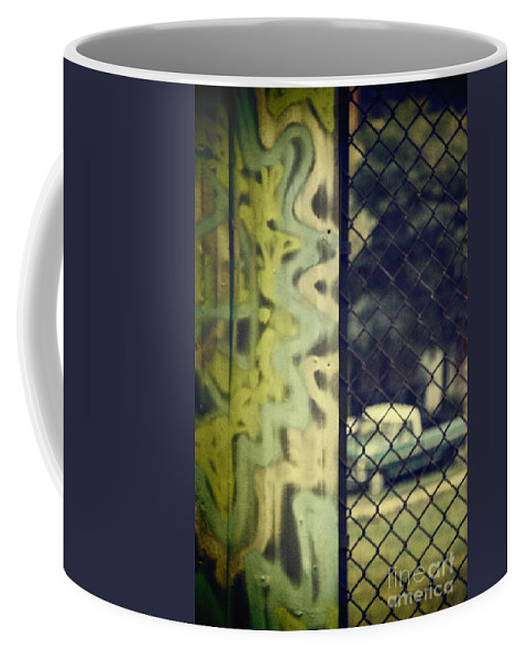 Graffiti Coffee Mug featuring the photograph Junk Yard by Margie Hurwich