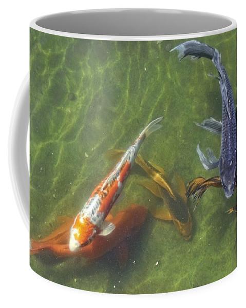 Koi Coffee Mug featuring the photograph Koi by Daniel Sheldon