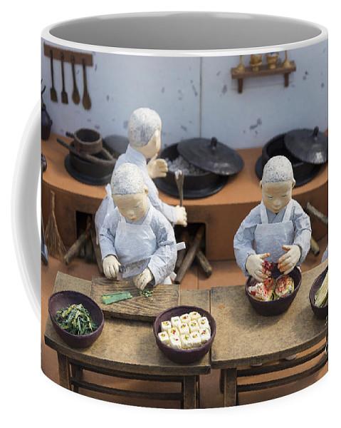 Asian Coffee Mug featuring the photograph Korean Monk Figures Preparing Traditional Food by Jacek Malipan