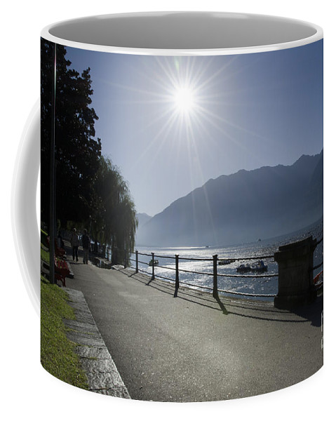 Lakefront Coffee Mug featuring the photograph Lakefront With Sun by Mats Silvan