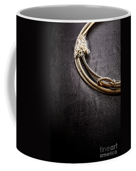 Rodeo Coffee Mug featuring the photograph Lasso On Leather by Olivier Le Queinec