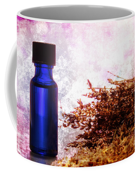 Aromatherapy Coffee Mug featuring the photograph Lavender Essential Oil Bottle by Olivier Le Queinec
