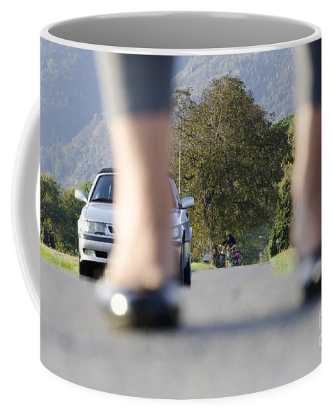 Woman Coffee Mug featuring the photograph Legs And Car by Mats Silvan