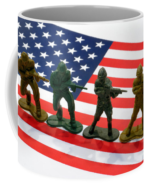 Aggression Coffee Mug featuring the photograph Line Of Toy Soldiers On American Flag Crisp Depth Of Field by Amy Cicconi