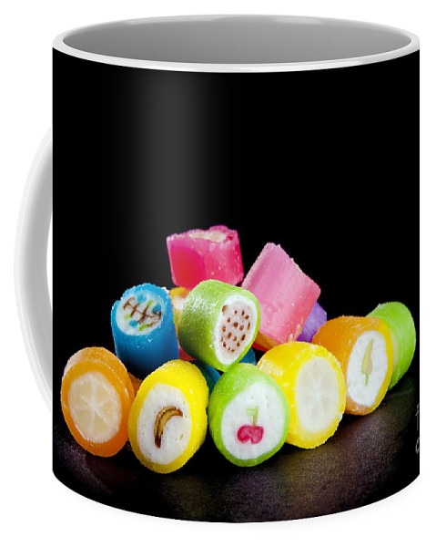 Black Coffee Mug featuring the photograph Lollies by Tim Hester