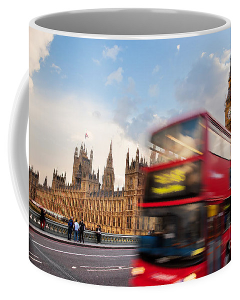 London Coffee Mug featuring the photograph London The Uk Red Bus In Motion And Big Ben by Michal Bednarek
