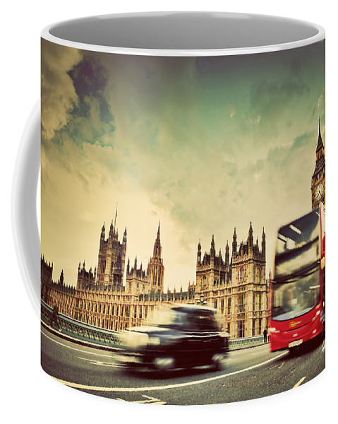 London Coffee Mug featuring the photograph London The Uk Red Bus Taxi Cab In Motion And Big Ben by Michal Bednarek