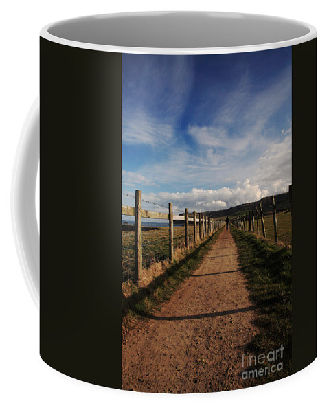 Blue Coffee Mug featuring the photograph Lone Walker On The North Yorkshire Coastal Path by Deborah Benbrook