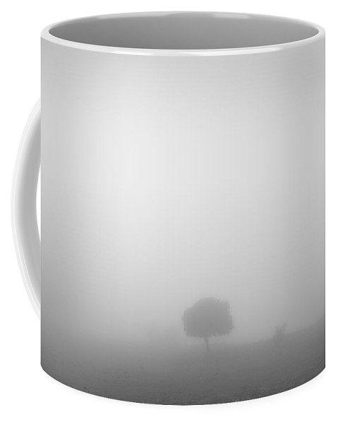 Black And White Coffee Mug featuring the photograph Lonely Tree At The Mist by Guido Montanes Castillo