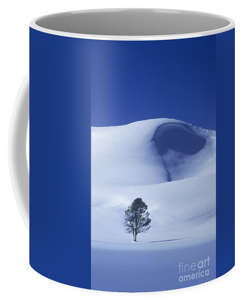 North America Coffee Mug featuring the photograph Lonely Tree In Winter Yellowstone National Park by Dave Welling