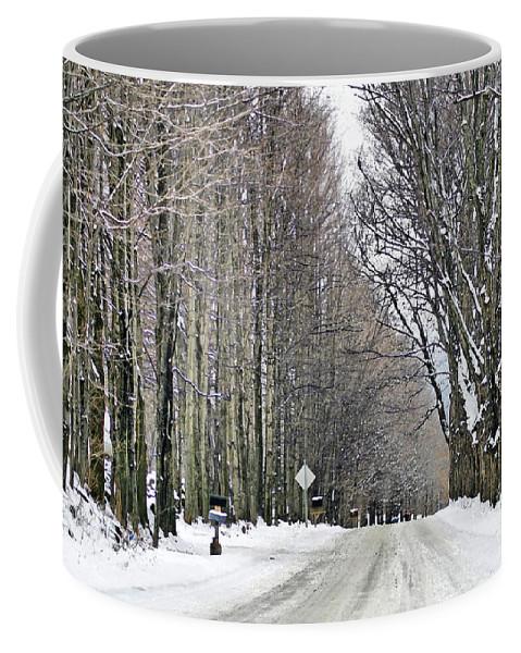 Winter Coffee Mug featuring the photograph Long Country Road by Deborah Benoit