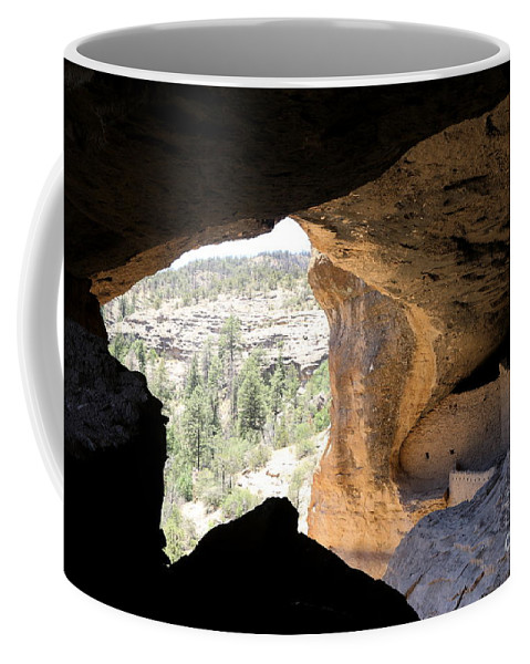 Cliff Coffee Mug featuring the photograph Looking Out Of A Cave Of Gila Dwellings by Christiane Schulze Art And Photography