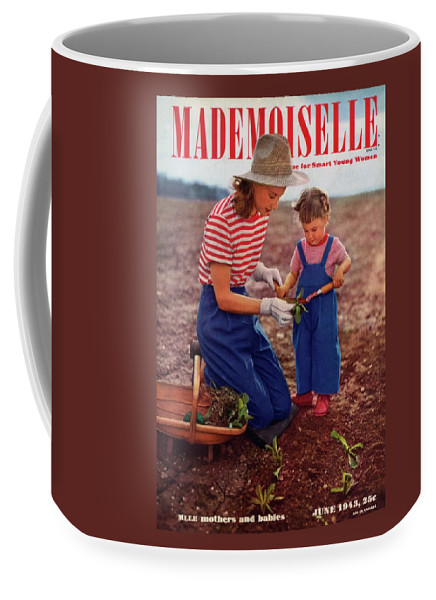 Fashion Coffee Mug featuring the photograph Mademoiselle Cover Featuring A Mother And Baby by Fernand Fonssagrives