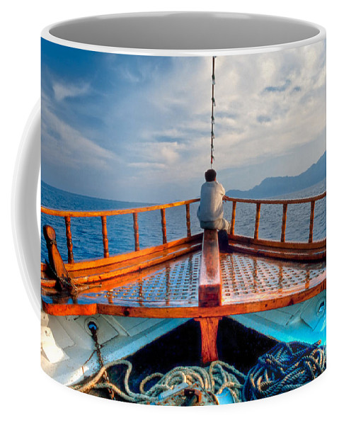 Aegean Coffee Mug featuring the photograph Man Day-deaming On Traditional Greek Ship by Stephan Pietzko