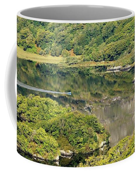 Killarney Coffee Mug featuring the photograph Man In Small Fishing Boat Travelling On Upper Lake Of Killarney National Park County Kerry Ireland by David Lyons