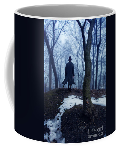 Young Coffee Mug featuring the photograph Man In Top Hat Walking Through Foggy Woods by Jill Battaglia