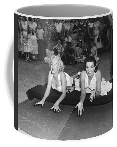 1950's Coffee Mug featuring the photograph Marilyn Monroe And Jane Russell by Underwood Archives