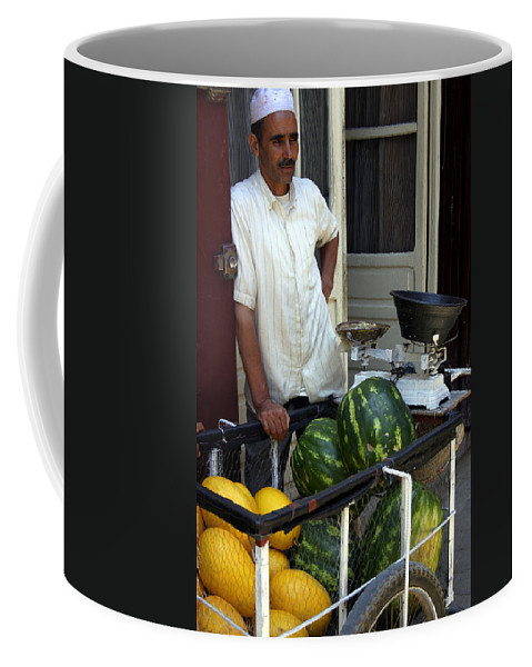 Melon Seller Coffee Mug featuring the photograph Melon Seller Old Medina Fez Morocco by PIXELS XPOSED Ralph A Ledergerber Photography