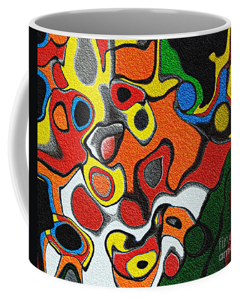 Melted Rubiks Cube Coffee Mug featuring the photograph Melted Rubiks Cube by Andee Design