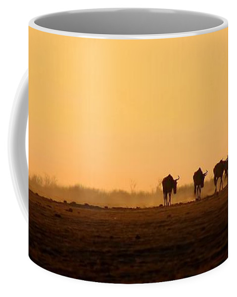 Wildebeests Coffee Mug featuring the photograph Migration by Amanda Stadther
