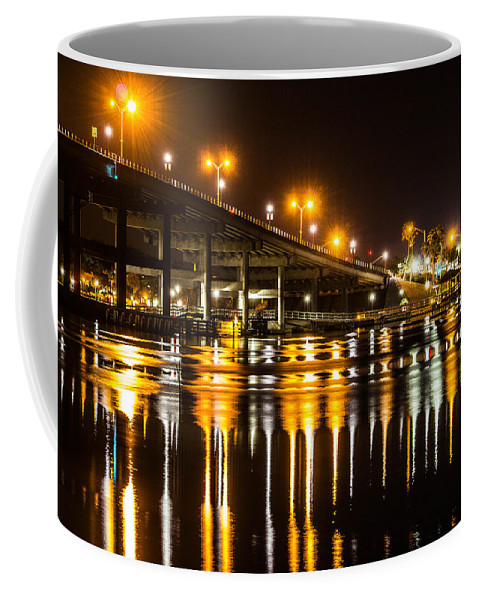 Nighttime Coffee Mug featuring the photograph Moving Reflection by Tyson Kinnison