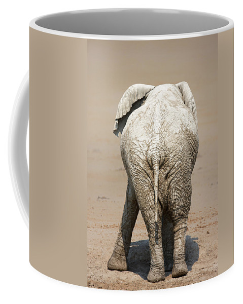 Elephant Coffee Mug featuring the photograph Muddy Elephant With Funny Stance by Johan Swanepoel