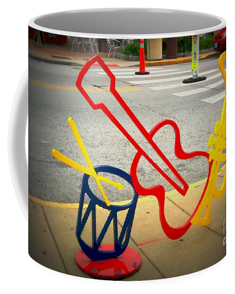 Coffee Mug featuring the photograph Musical Instruments Bike Rack by Kelly Awad