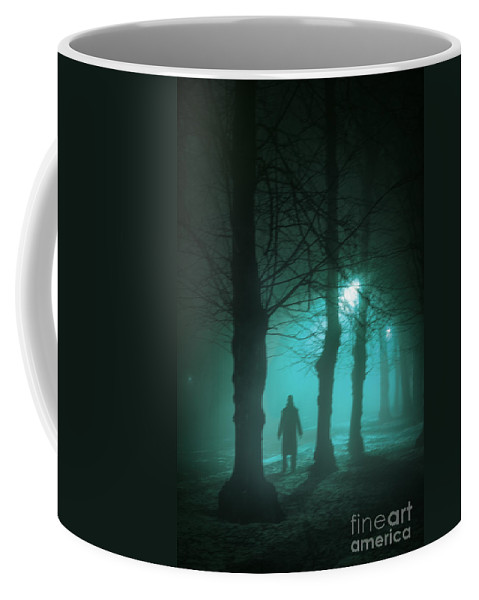 Man Coffee Mug featuring the photograph Mysterious Man In A Foggy Forest by Lee Avison