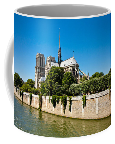 Notre Dame Coffee Mug featuring the photograph Notre Dame Cathedral And The Seine by Anthony Doudt