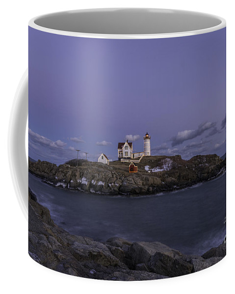 Lighthouses Coffee Mug featuring the photograph Nubble Lighthouse by Sharon Seaward