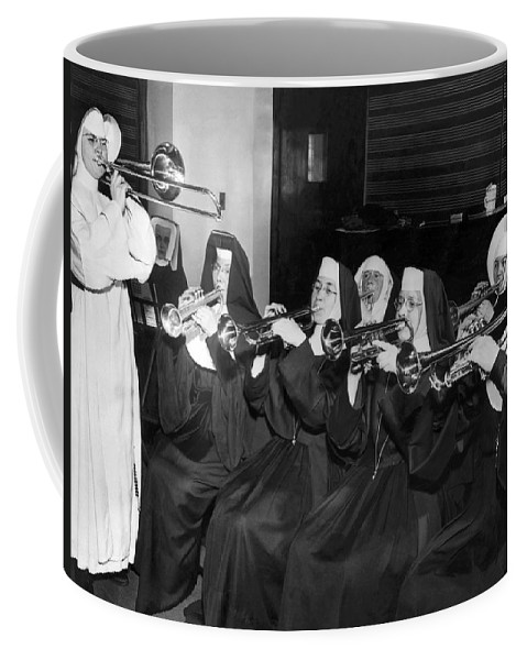 1945 Coffee Mug featuring the photograph Nuns Rehearse For Concert by Underwood Archives