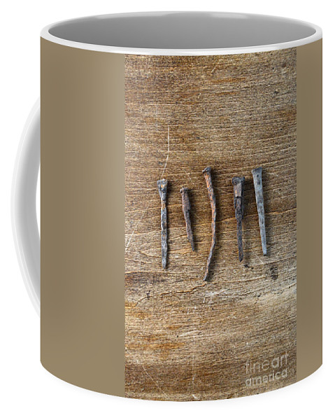 Nail Coffee Mug featuring the photograph Old Nails On A Wooden Table by Jill Battaglia