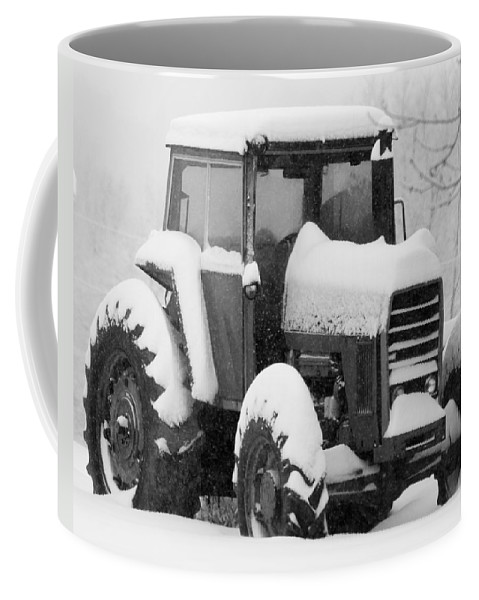 Snow Coffee Mug featuring the photograph Old Tractor In The Snow by Jan M Holden