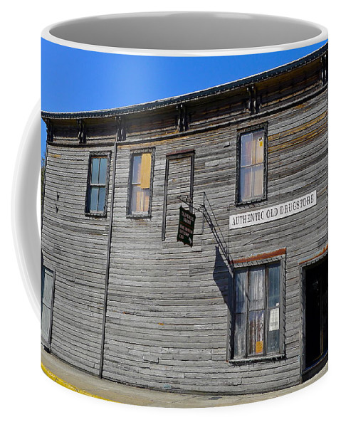 Authentic Old Drug Store Coffee Mug featuring the photograph Oldest Drug Store by Denise Mazzocco