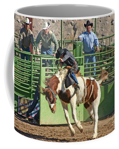 Cowboy Coffee Mug featuring the photograph Out Of The Chute by Bob Hislop