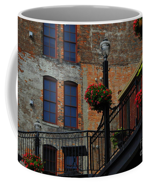 Urban Coffee Mug featuring the photograph Pearl Street Grill by Kathleen Struckle