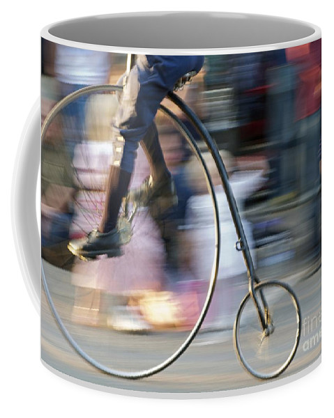 Bicycle Coffee Mug featuring the photograph Pedaling Past by Ann Horn