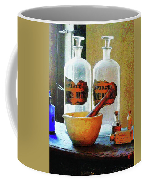 Druggist Coffee Mug featuring the photograph Pharmacist - Mortar And Pestle With Bottles by Susan Savad