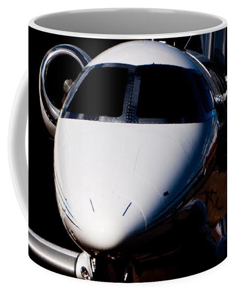 Embraer Phenom 100 Coffee Mug featuring the photograph Phenom by Paul Job