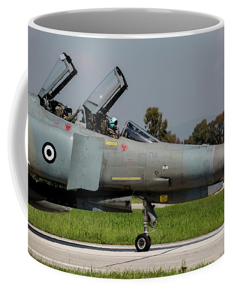 Greece Coffee Mug featuring the photograph Pilots Sitting In The Cockpit by Timm Ziegenthaler