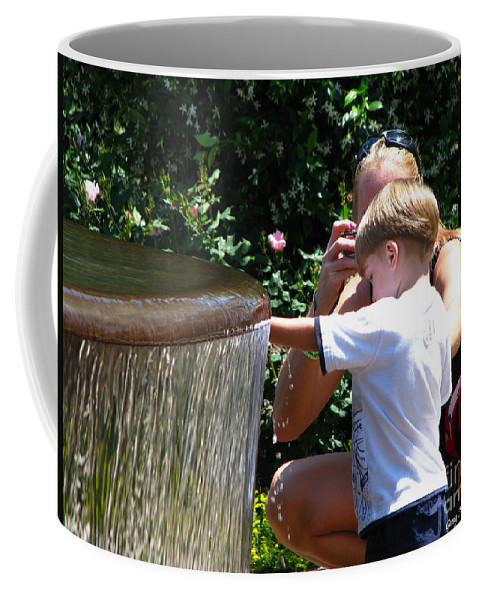 Art For The Wall...patzer Photography Coffee Mug featuring the photograph Playing In Water by Greg Patzer