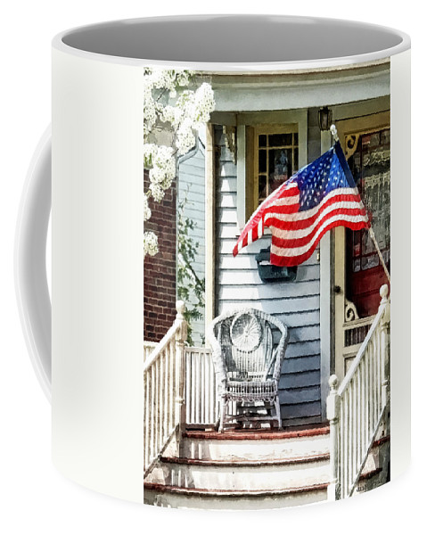 Flag Coffee Mug featuring the photograph Porch With Flag And Wicker Chair by Susan Savad