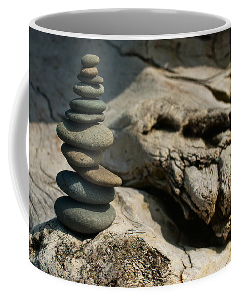 Zen Coffee Mug featuring the photograph Precarious Cairn by Jani Freimann