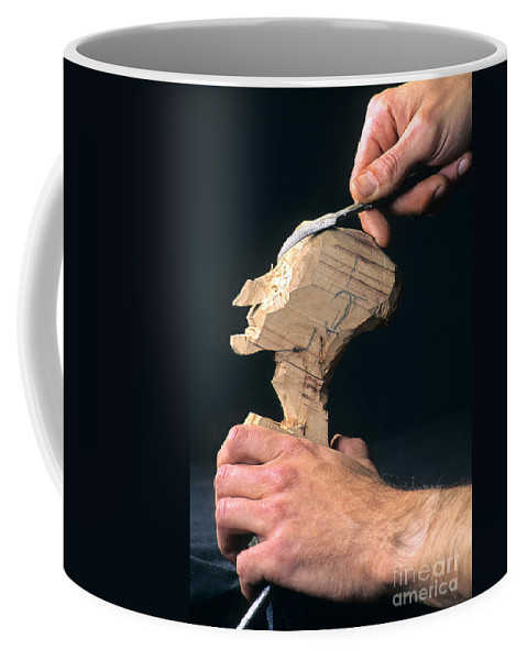 Craftsman Coffee Mug featuring the photograph Puppet Being Carved From Wood by Bernard Jaubert