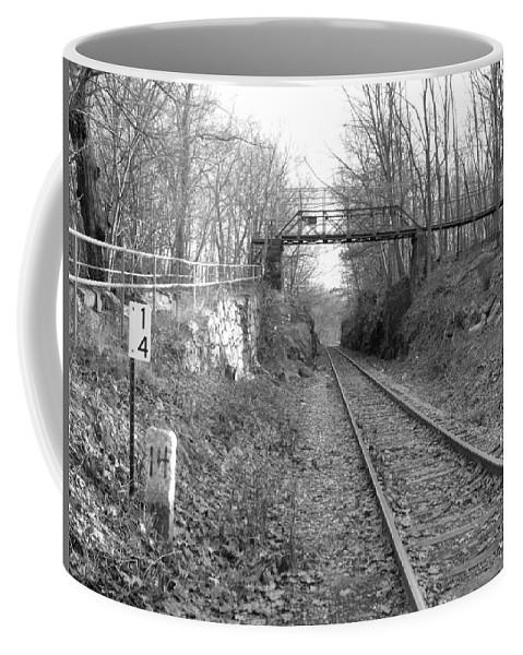 Railroad Coffee Mug featuring the photograph Rails by Geoffrey McLean