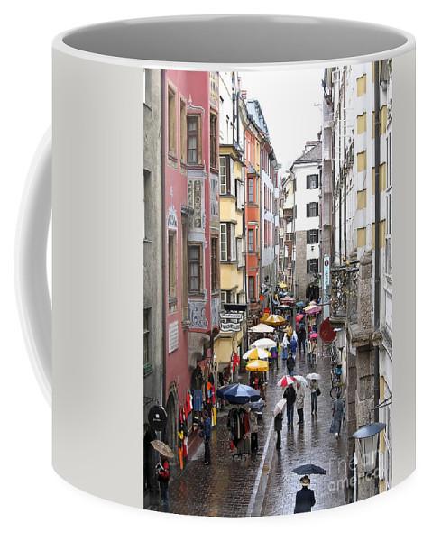 Innsbruck Coffee Mug featuring the photograph Rainy Day Shopping by Ann Horn