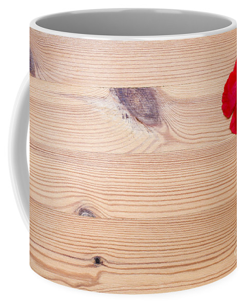 Freshness Coffee Mug featuring the photograph Red Flower On Wood by Gal Eitan