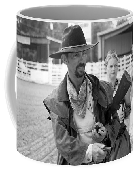 Rodeo Coffee Mug featuring the photograph Rodeo Gunslinger With Saloon Girls Bw by Sally Rockefeller