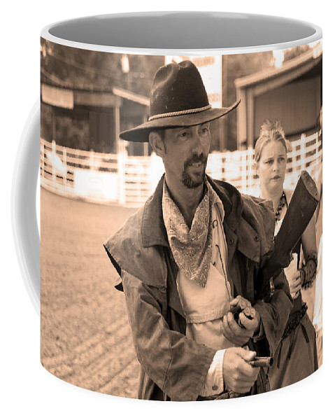 Rodeo Coffee Mug featuring the photograph Rodeo Gunslinger With Saloon Girls Sepia by Sally Rockefeller